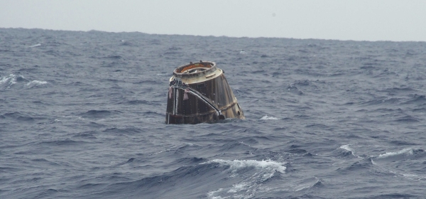 SpaceX Dragon bobs in the Pacific after historic splashdown
