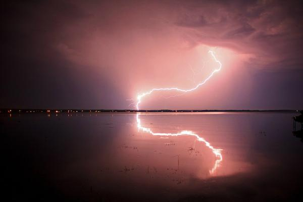 lightning reflected in water