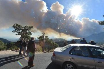 Visitors stop at 3M curve to watch the smoke. (Photo: Walt Hester)
