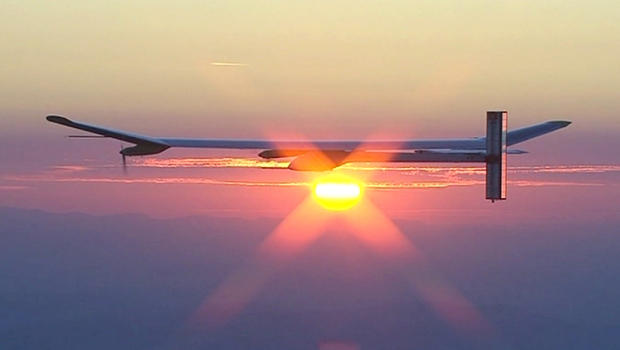 Solar Impulse greets the dawn after flying all night on solar power. (Photo: CBS/60 Minutes)