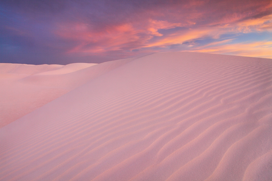 """""""White Sands at Sunset."""" White Sands National Monument, New Mexico. Pure white gypsum sand dunes soak up the warm glow of sunset reflected from the clouds above. Photo: Nate Zeman. Used with permission."""