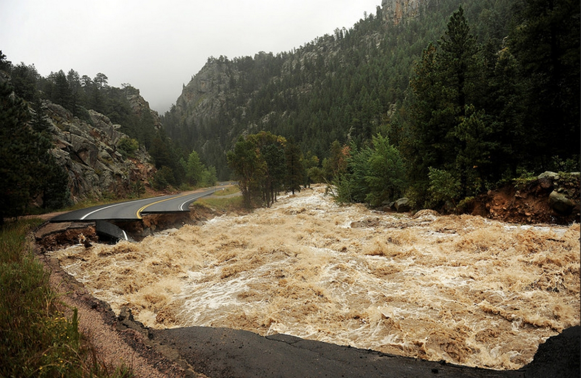 No single photo can show last year's widespread damage, but here you can see how the swollen South St. Vrain Creek destroyed Highway 7 west of Lyons. (Photo: Denver Post)