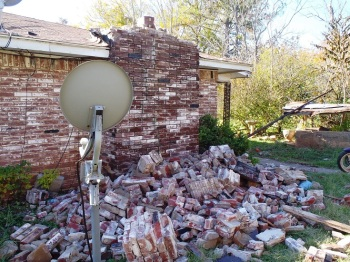 House damage in central Oklahoma from the magnitude 5.6 earthquake on Nov. 6, 2011. Research conducted by USGS geophysicist Elizabeth Cochran and her university-based colleagues suggests that this earthquake was induced by injection into deep disposal wells in the Wilzetta North field. (Image: Brian Sherrod, USGS)