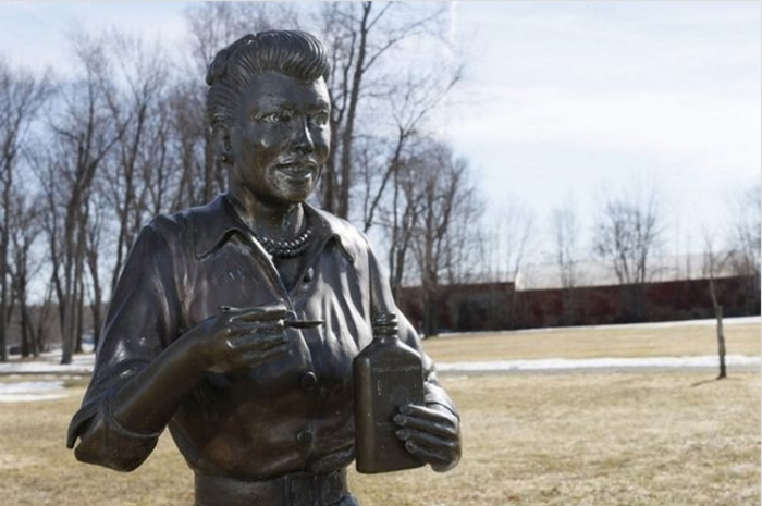 The statue looks a little better in this shot, but it still bears no resemblance to Lucille Ball. For those too young to remember, that's her famous Vitameatavegamin bottle. (Photo: Derek Gee/Buffalo News)