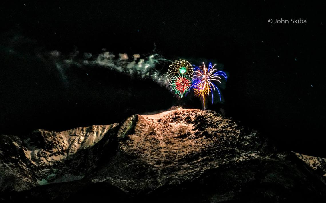 New Year's Eve fireworks on Pikes Peak. Copyright John Skiba. Reprinted with permission.