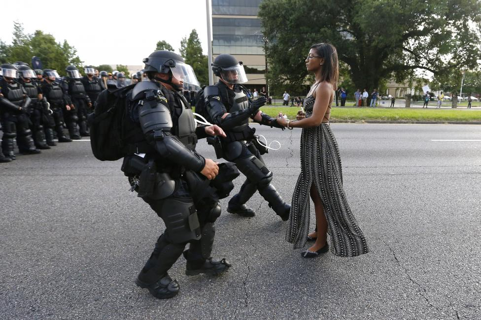 At Saturday's demonstration protesting the shooting death of Alton Sterling, Ieshia L. Evans, 35, is detained by Louisiana State Police officers in Baton Rouge, Louisiana. (Jonathan Bachman/Reuters)