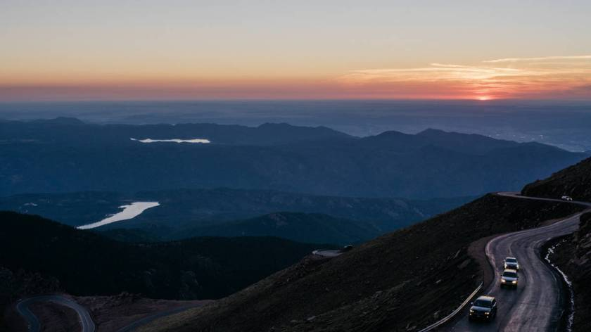 Fans show up before sunrise to reach their vantage points. (Photo by Benjamin Rasmussen)
