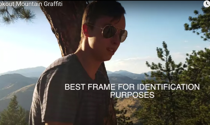 Screenshot from the video of Stanley Stettler, 18, spray-painting boulders on Lookout Mountain