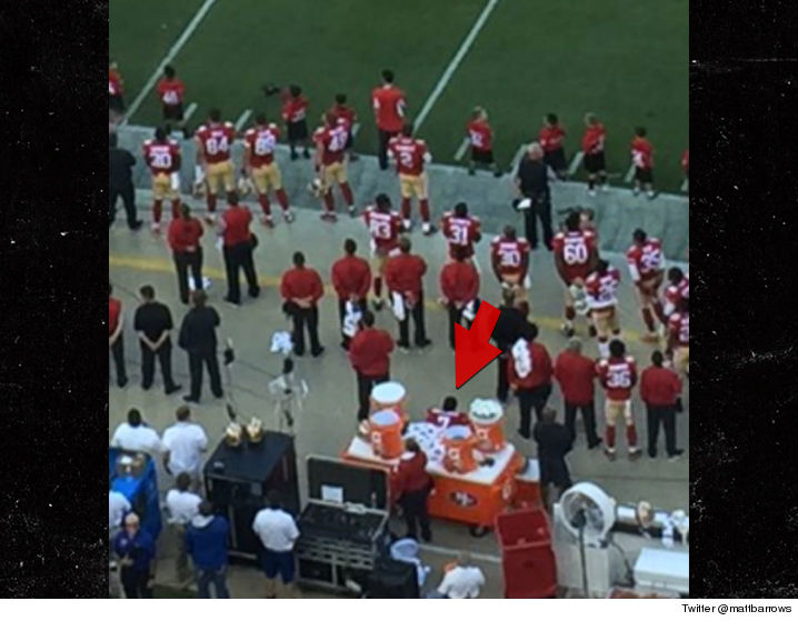 Kaepernick remains seated during the national anthem