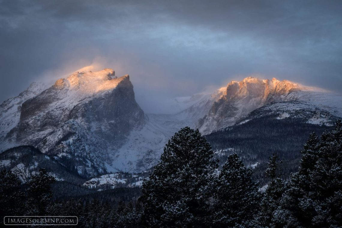 Untitled. Morning light glows on Hallett Peak and Flattop Mountain in Rocky Mountain National Park. Photo © Erik Stensland. Reprinted with permission.