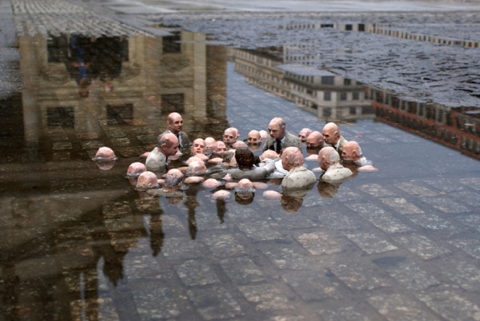 Street art in Berlin by Isaac Cordal