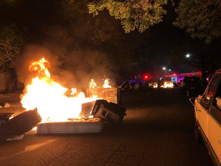 Three dumpsters burn during Denver protest Saturday night
